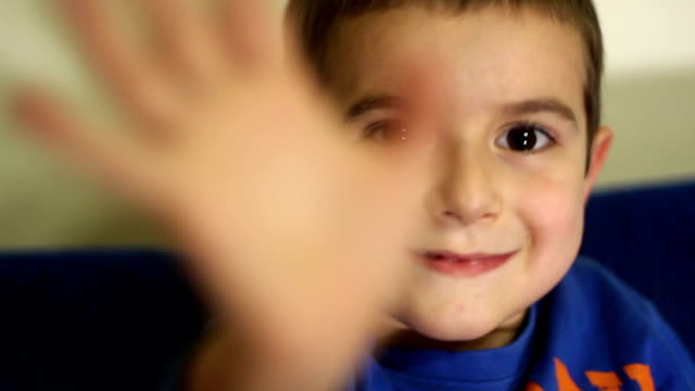 Kid waving hand video