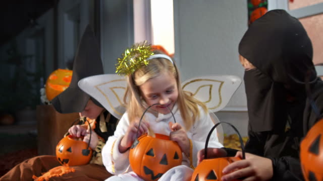 HD DOLLY: Kids Checking Out Their Halloween Candy video