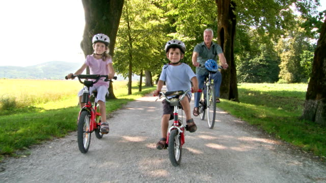 HD: Kids Cycling With Their Grandfather video