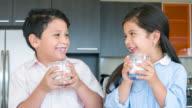 Kids drinking milk at home video