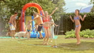 SLO MO Kids enjoying a garden party on a hot summer day video