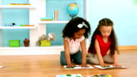 Kids finger painting on sheets of paper video