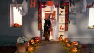 HD CRANE: Kids Going Trick Or Treading On Halloween video