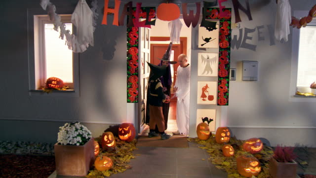 HD CRANE: Kids Going Trick Or Treading On Halloween video