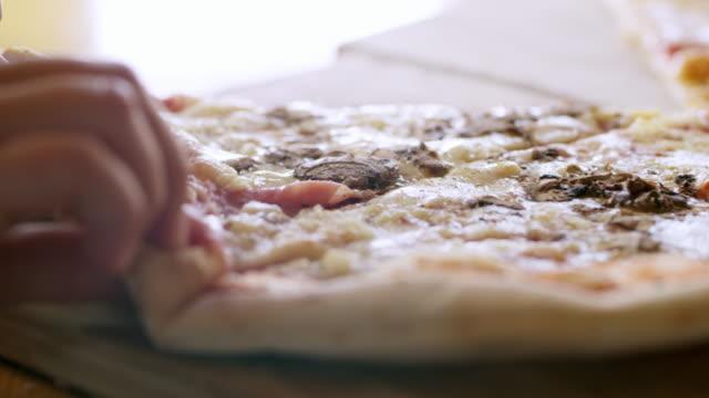 CU Kid's hands grabbing piece of pizza video