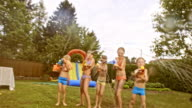 POV Kids having a water gun fight at a party in the backyard video
