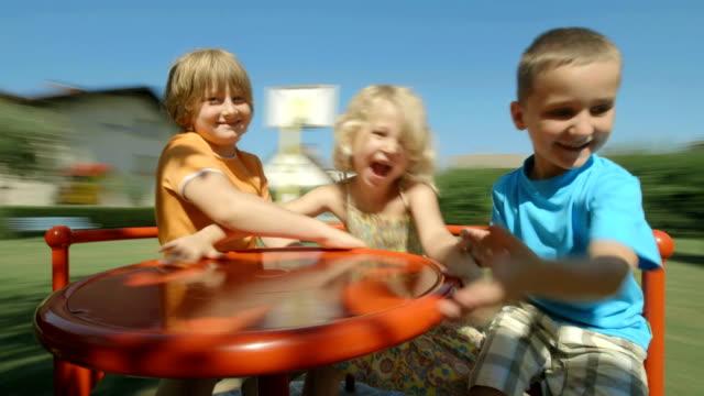 HD: Kids Having Fun On Merry-Go-Round video