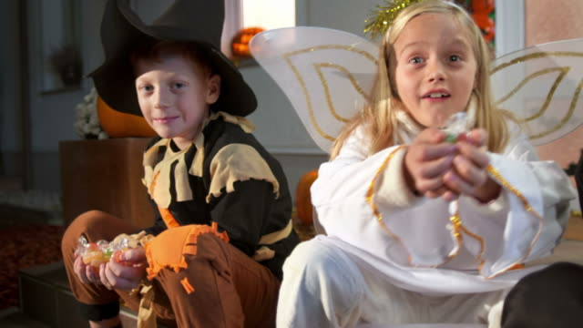 HD DOLLY: Kids Holding Out Their Halloween Candy video