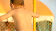 kids jump and lie on the trampoline video