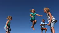 Kids jumping on trampoline, slow motion video