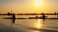 Kids kayaking on the lake at sunset video