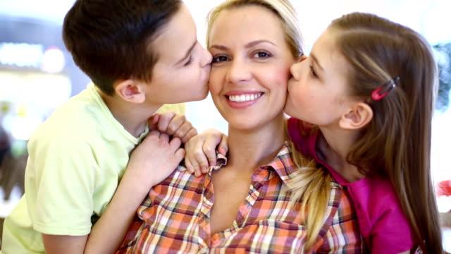 Kids kissing their mom. video