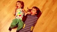 kids licking lollipops video