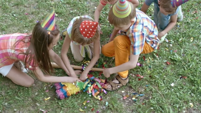 Kids Looking for Something In Pinata video