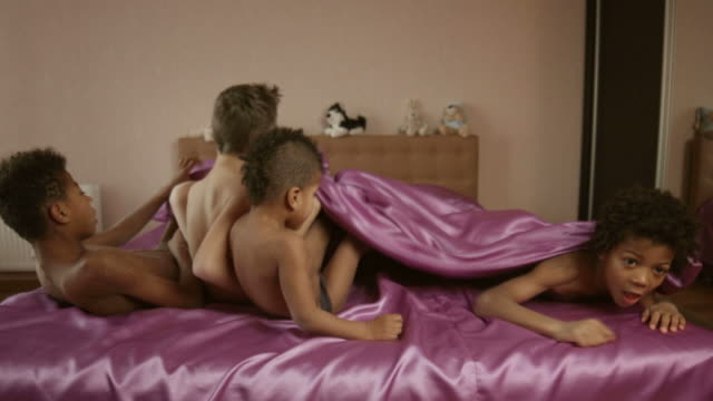 Kids lying on bed. video
