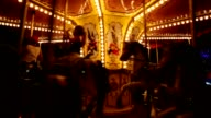 Kids on carousel merry-go-round amusement ride video