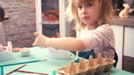 Kids Painting Easter Eggs video