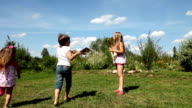 Kids play with soap bubbles video