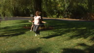 Kids playing in yard, super slow motion video