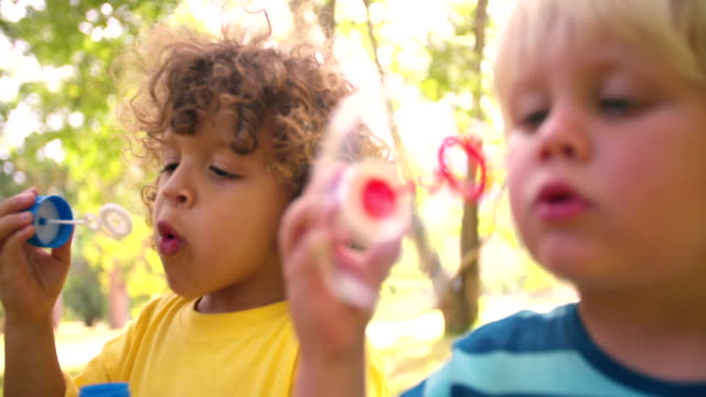 Kids playing with bubbles together having fun video