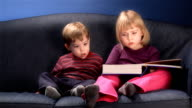 kids reading a book video