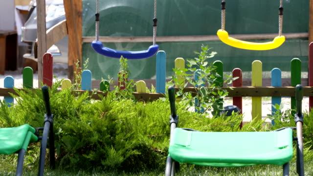 Kids swing set on playground in backyard video