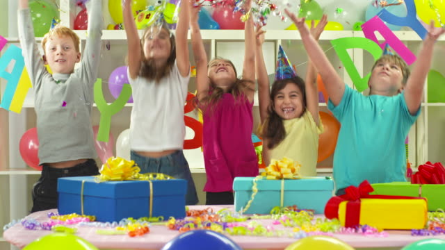 HD: Kids Throwing Confetti Up In The Air video