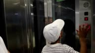 Kids waiting for elevator to arrive. Young boys in front of elevator waiting video