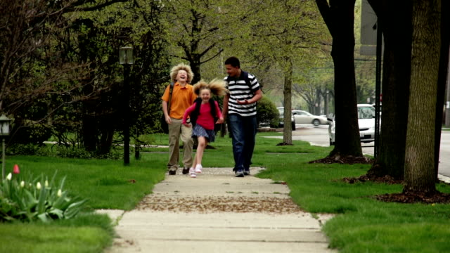 Kids walking to school on the sidewalk video