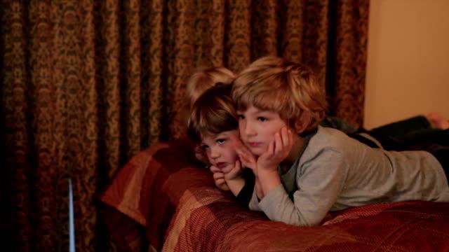 Kids Watching TV In Hotel video