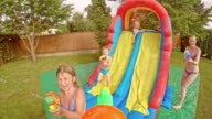 POV Kids' water gun fight at a party video