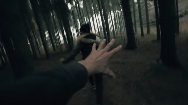 POV Killer chasing a woman through the forest video