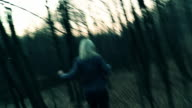 HD: Killer Chasing Young Woman In The Forest video