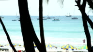King's Cup Regatta. Kata beach, Phuket, Thailand. Yachts, and beach area with sun shades on the Sea. video