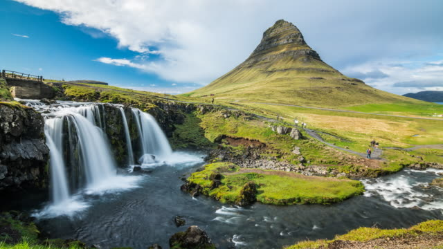 Kirkjufell mountain and Kirkjufellsfoss waterfall in Iceland time lapse video