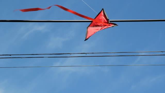 Kite stuck in wires. 2 shots. video