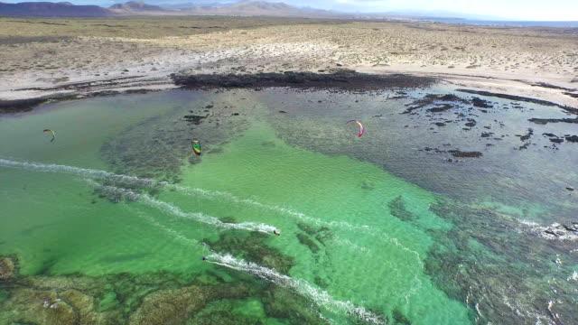 AERIAL: Kiteboarders riding in big beautiful flat-water lagoon video
