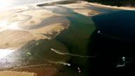Kites in laguna near the ocean aerial video