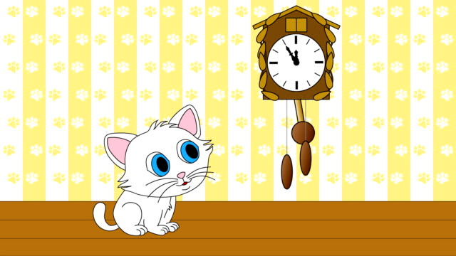 Kitten watching cuckoo clock video