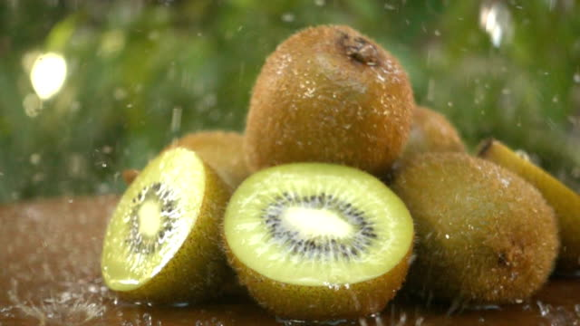 kiwi fruit being washed on green video