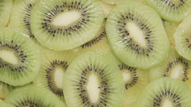 TOP VIEW: Kiwi slices are rotating video