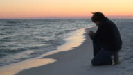 Kneeling Prayer At Sunset video