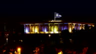 Knesset with flying waving flag of Israel at night video