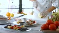 Knife cuts pear in half. video