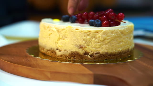 Knife cutting cheese cake on wood table video