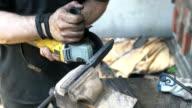 Knife maker gringind down edges on blade video