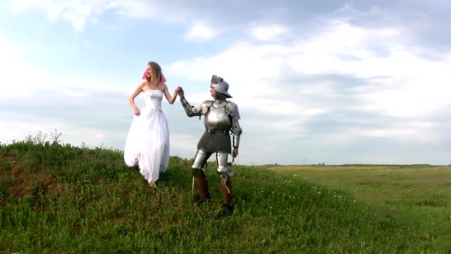 Knight and bride coming down the hill video