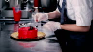 Konditer adorns the top of the cake raspberries. video