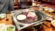 Korean barbecue. Typical celebration on Korea at any important event. video