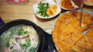 Korean food, kimchi pancake, ginseng chicken soup and variety of side dishes video